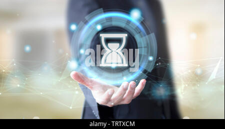 businessman hand with digital technology sand clock concept - Stock Image