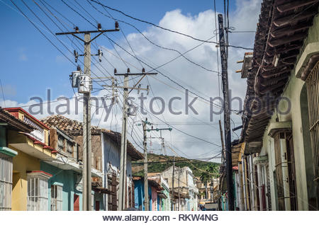 November 25, 2011.  Street in Trinidad, Cuba, showing electrical cables connecting to homes. - Stock Image
