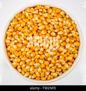 Bowl of Uncooked Raw Popcorn Maize - Stock Image