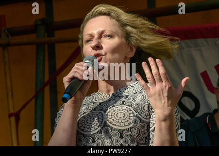 London, UK. 13th October 2018.   Author and jouralist Louise Raw speaks at the rally in London to oppose racism  and fascism close to where the racist, Islamophobic DFLA were ending their march on Whitehall bringing together various groups to stand in solidarity with the communities the DFLA attacks. The event was organised by Stand Up To Racism and Unite Against Fascism. Peter Marshall/Alamy Live News - Stock Image