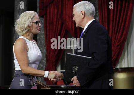 US Senator Kyrsten Sinema, Democrat of Arizona, is sworn in by Vice President Mike Pence on Capitol Hill in Washington, DC on January 3, 2019. - Stock Image