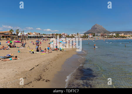 Xabia Spain Playa del Arenal beach in summer with blue sky and people, also known as Javea - Stock Image