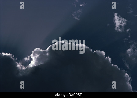 Clouds silhouetted by the sun - Stock Image