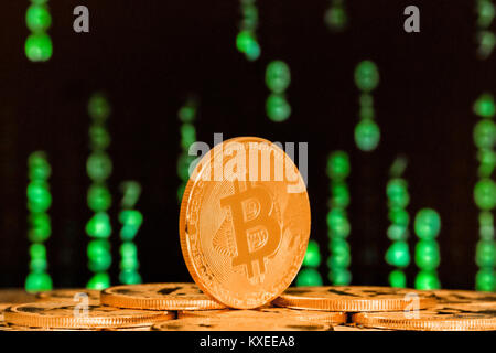 close up of bitcoin with numbers in backgrounds - Stock Image