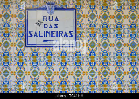 Azulejos (blue tiles) street signs 'Rua das Salineiras' on wall on blue and yellow tiles.  Aveiro, Portugal - Stock Image
