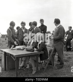 1967, competitors at a clay pigeon siging in? - Stock Image