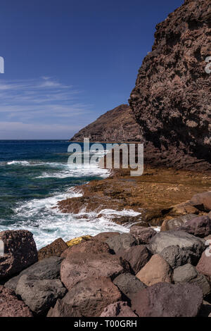 Volcanic coastline at Puerto de Aldea, Gran Canaria, Canary Islands - Stock Image