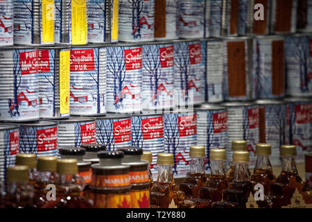 MONTREAL, CANADA - NOVEMBER 9, 2018: Maple Syrup metal can for sale on Montreal Jean Talon market. Quebec is the highest producer of Maple syrup in th - Stock Image