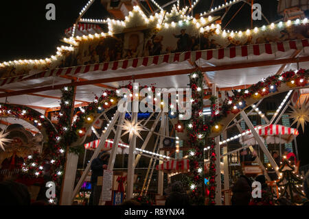 Dresden, Germany, December 14., 2018: Night shot at Strietzelmarkt with the illuminated little Ferris wheel in the centre of the Christmas Market - Stock Image