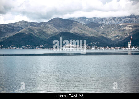 Beautiful view of the mountains and the sea with a ship in Montenegro near the coastal city of Tivat. - Stock Image