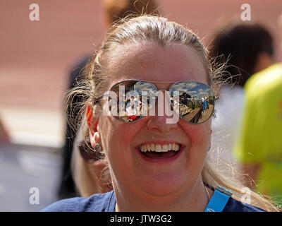 Sheffield, UK. 10th August, 2017. Spectators refelected in sunglasses of one supporter at Special Olympics National Games in Sheffield Credit: Steve Holroyd/Alamy Live News - Stock Image