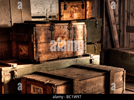 Wooden crate with explosive warning label - Stock Image