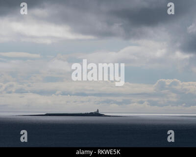 View of the beach at Alnmouth with Coquet Island in the distance. - Stock Image