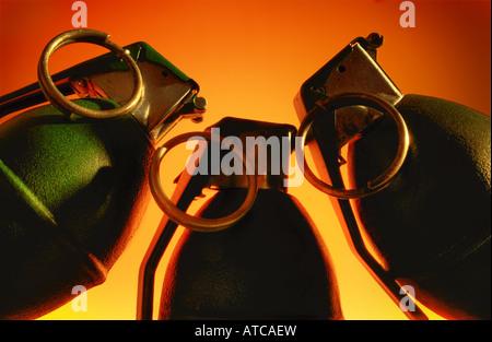 Three hand grenades posing menacingly. - Stock Image