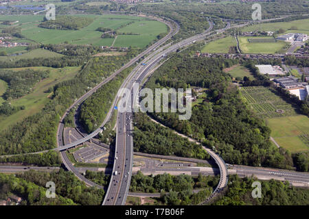 aerial view of the M60 motorway at J14 with A580 road, the Wardley Park & Ride, looking north towards the M61. Worsley, Manchester - Stock Image
