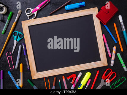 School office supplies on a desk with copy space. Back to school concept - Stock Image