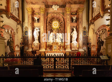 Catedral de Malaga interior; A man praying at the Chapel of the Incarnation,  Malaga Cathedral, Malaga old town, Andalucia Spain - Stock Image