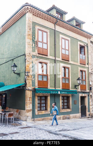 Gijon, Spain - 6th July 2018: Man walks past Casa Zabala in the old fishermans quarter. The area is known as Cimadevilla - Stock Image