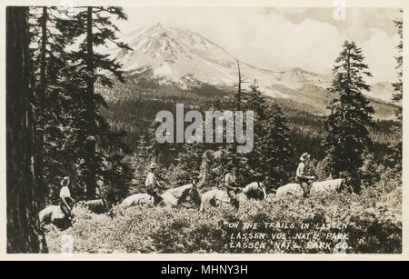 Riders on the trail in Lassen Volcanic National Park, California, USA.      Date: circa 1940 - Stock Image