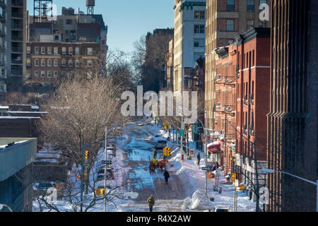 DUMBO in Brooklyn on a sunny winter day with deep snow on the strret - Stock Image