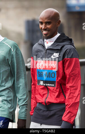 London,UK,24th April 2019,Sir Mo Farah attends The London Marathon Elite Mens Photocall which took place outside the Tower Hotel with Tower Bridge in the background ahead of the Marathon on Sunday.Credit: Keith Larby/Alamy Live News - Stock Image