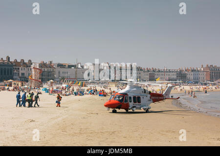 Weymouth, Dorest, UK. 21st Jun, 2017. Coastguard helicopter lands on Weymouth Beach after person collapses, Dorset - Stock Image