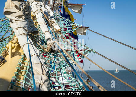 Bowsprit and furled fore sails on square-rigged ship Mir (Peace) in Russian at dock for Tall Ships race Lisbon 2016 - Stock Image