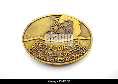 AA brass belt buckle publicity material from the Red Adair Company Wild Well Control Oil Well fires and Blowout - Stock Image