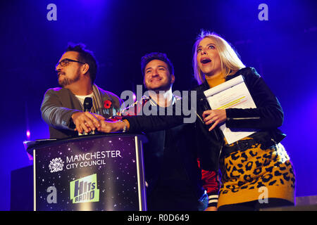 Manchester, UK. 3rd November, 2018. Jonas Blue centre, with left Mike Toolan and Kelly Pegg from Hits Radio turn on the Christmas Lights at the Manchester Town Hall Credit: Della Batchelor/Alamy Live News - Stock Image
