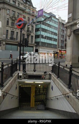 London, UK. 25th Dec, 2018: Oxford Street Station entrance. Streets in the City of London were virtually empty on Christmas day with no public transport running on 25th December 2018. Some parts of the city experienced dense fog which is expected to linger for the rest of the week. Credit: David Mbiyu/Alamy Live News - Stock Image