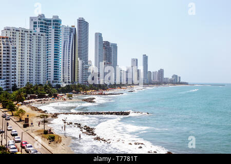 Cartagena Colombia Bocagrande Caribbean Sea public beach surf high rise condominium apartment residential buildings oceanfront city skyline - Stock Image