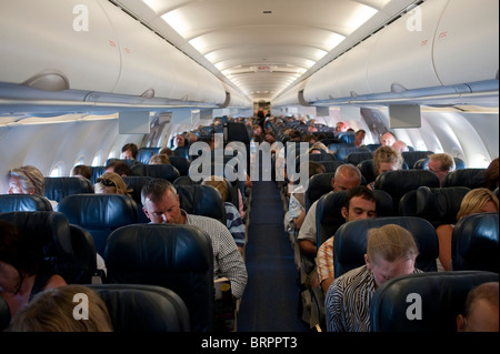 Aircraft cabin full of passengers - Stock Image