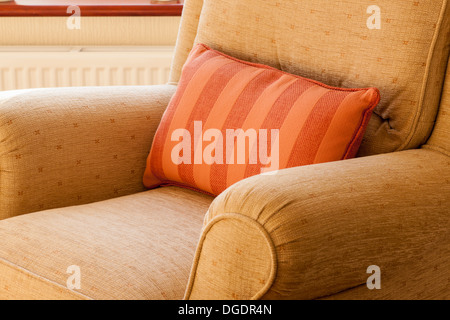 comfortable arm chair in a room - Stock Image