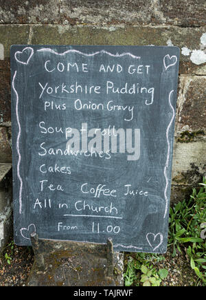 Yorkshire Puddings on menu outside church cafe. Yorkshire, UK - Stock Image