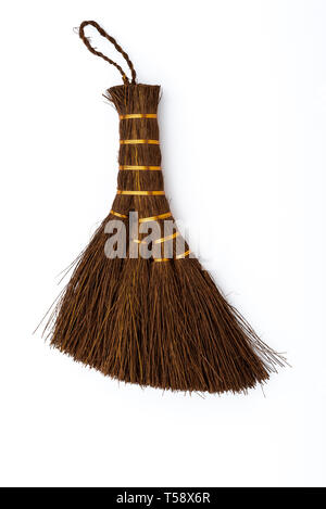 Small hand brush used in the maintenance of bonsai trees, especially removing litter from moss. - Stock Image