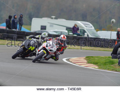 East Fortune, UK. 14 April, 2019.  17 Gordon MacDonald leads 18 Clint Walker through Hannah's in a Scottish Superbikes and Formula Melville Championship race at East Fortune Raceway, during the opening rounds of the 2019 Scottish Championships, Melville Open and Club Championships. Credit: Roger Gaisford/Alamy Live News - Stock Image