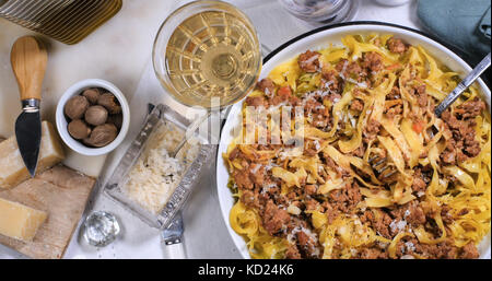 Top down view of delicious steamy fettuccine (pasta) in bolognese sauce - Stock Image