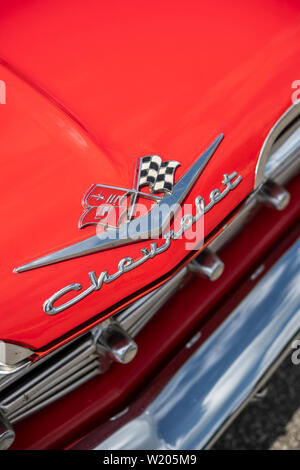 Detail of the bonnet of a red 1959 Chevrolet car - Stock Image