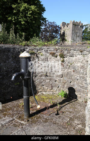 Water Pump near Burnchurch castle, A 15th century Norman tower house, situated in County Kilkenny, Ireland - Stock Image