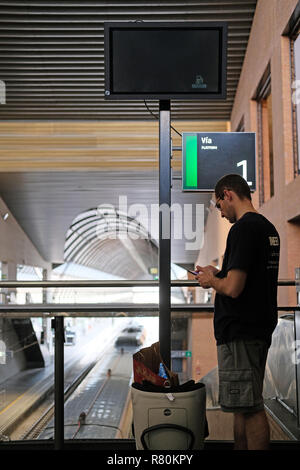 A man waiting for a train at Seville station. - Stock Image