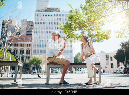 Senior man taking photos of his woman. Mature couple having fun on their holiday. - Stock Image