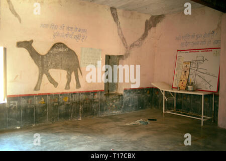 Inside a school room in a basic school in a rural Bishnoi village, India. - Stock Image