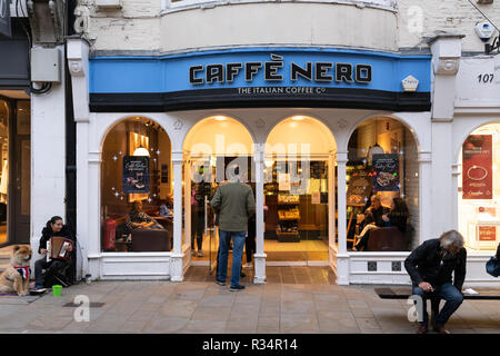 A man entering a Cafe Nero coffee shop on Winchester High Street, England - Stock Image