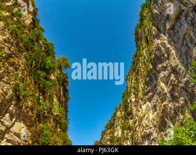 View between two rock formations to mountains in background - Stock Image
