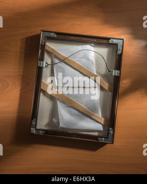 back of frame with hidden envelope - Stock Image
