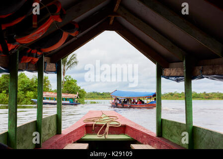 Riverboats in Nanay River, in Iquitos, Peru framed by boat structure. Nanay River connects the city to Amazon River. - Stock Image