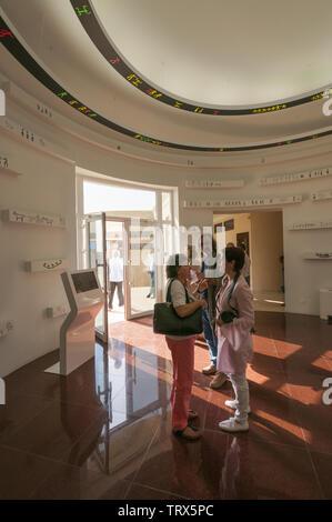 Azerbaijan, Gobustan, Gobustan Rock Art Cultural Landscape, Visitor Center interior with people; UNESCO World Heritage Site - Stock Image