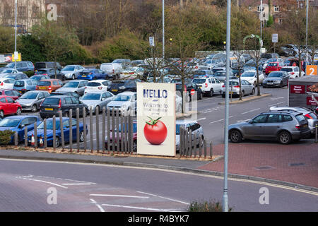 A view over the busy Trowbidge Tesco extra car park with the 'hello' welcome sign prominent. - Stock Image