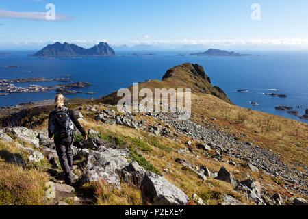 Young Woman, Hiking, View, Tjeldbergtinden, Austvagoya, Lofoten, Norway, Europe - Stock Image