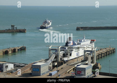 Dover, Kent, UK - September  30 2018: A ferry sails out of the port of Dover bound for Calais, France. The coastal town of Dover and the medieval Dover Castle overlooks the town from the iconic White Cliffs. . Credit: David Mbiyu - Stock Image